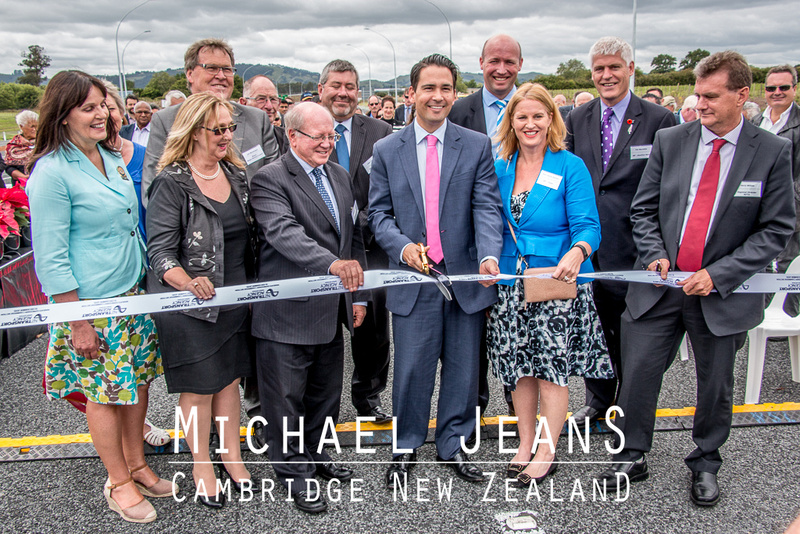 Transport Minister Simon Bridges surrounded by our mayors and MPs et al. for the ribbon cutting